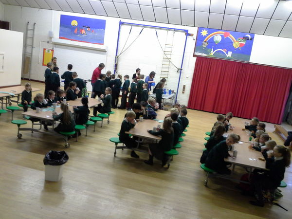 Pupils enjoying mugs of hot chocolate